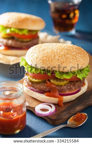 burger with beef patty lettuce onion tomato ketchup fresh burgers on ...