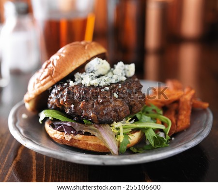 burger with blue cheese served with beer - stock photo