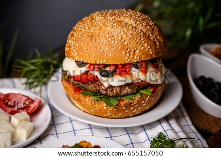 Burger with cheese on rustic style background