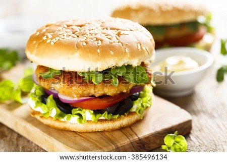 Burger with chicken and olives - stock photo