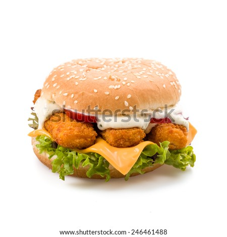 Burger with fish fingers fresh lettuce, tomato and tartar sauce