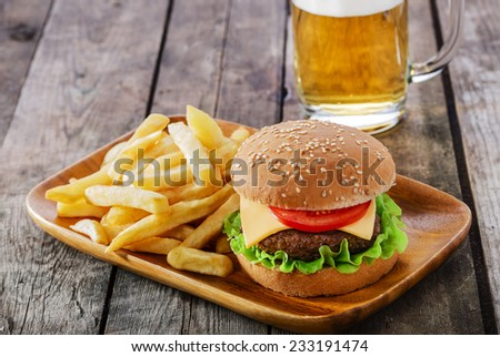 burger with French fries cutlet with cheese and tomato - stock photo