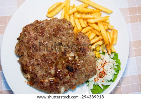Burger with french fries served on a table - top view - stock photo