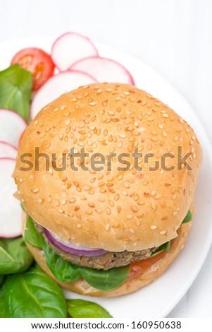 burger with fresh salad, top view, close-up - stock photo