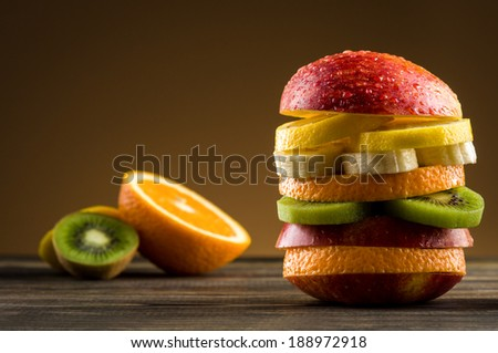 Burger with fruit - stock photo