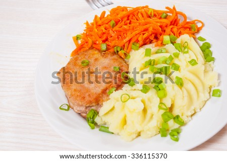burger with mashed potato and carrot salad