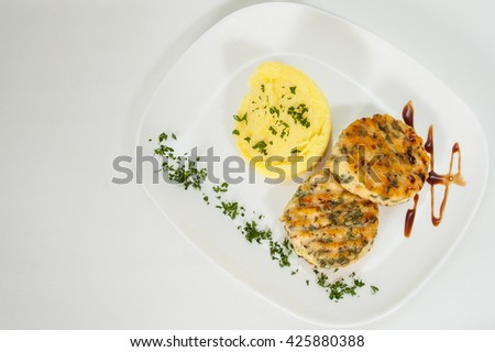 burger with mashed potatoes on plate - stock photo