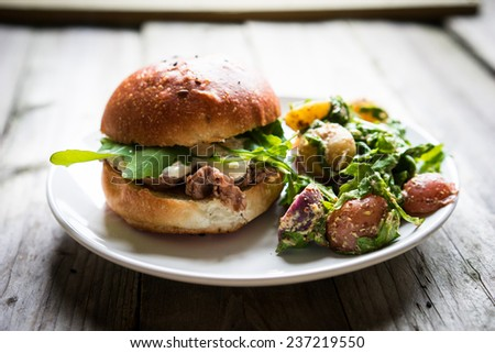 Burgers on wooden background - stock photo