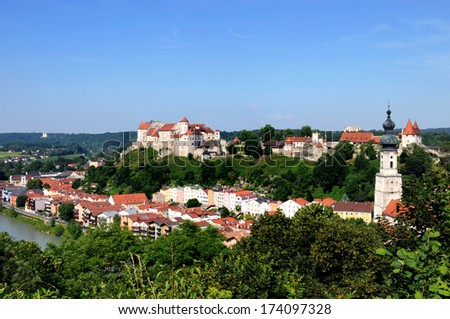 Burghausen is a small town in Upper Bavaria and has been founded in 1025. Its castle atop a ridge is the longest castle in Europe (1043 m) - stock photo