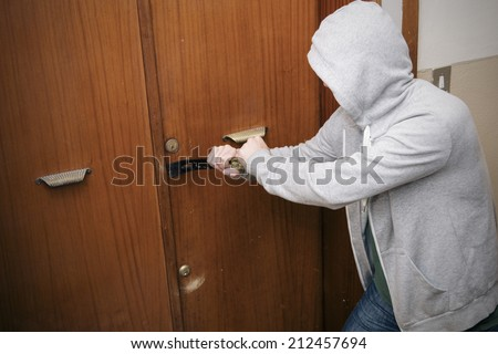 burglar breaking the house door - stock photo