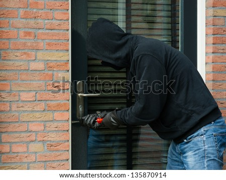 Burglar carrying the tool of choice - stock photo