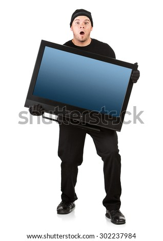 Burglar: Caught While Stealing Television - stock photo