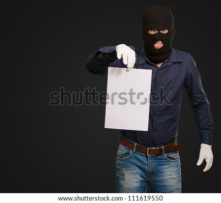 Burglar In Face Mask On Black Background - stock photo