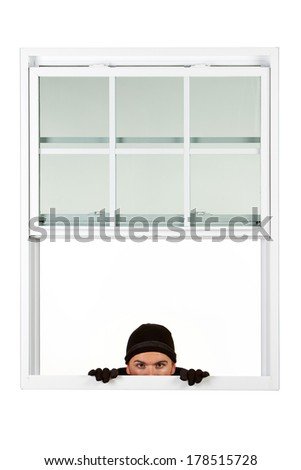 Burglar: Man Looking Into Your Window - stock photo