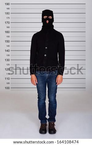 Burglar Standing Against Police Lineup Stock Photo - Image