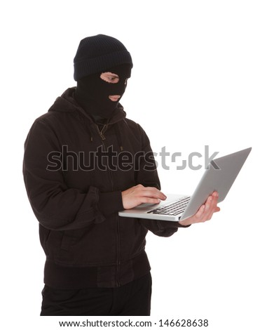 Burglar Wearing Mask Holding Laptop Over White Background