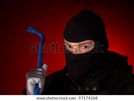 burglar with black cowl - stock photo