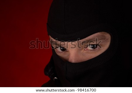 burglar with black cowl - stock photo