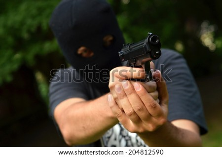 Burglar with 9mm pistol