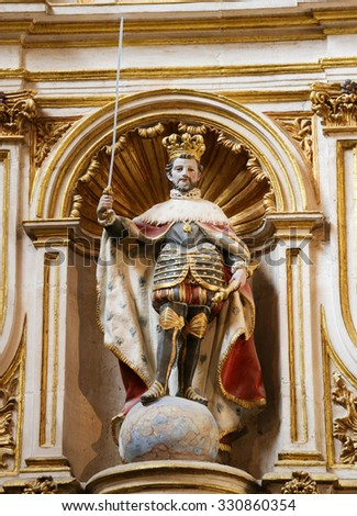 BURGOS, SPAIN - AUGUST 13, 2014: Polychrome Statue of Spanish Emperor Carlos I of the House of Habsburg, standing on a globe, in the Cathedral of Burgos, Castille, Spain