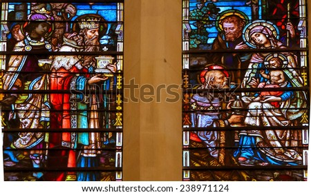 BURGOS, SPAIN - AUGUST 13, 2014: Stained glass window depicting the Epiphany in the cathedral of Burgos, Castille, Spain. - stock photo