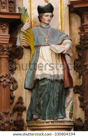 BURGOS, SPAIN - AUGUST 13, 2014: Statue of Saint Julian of Cuenca (1127-1208) in the Cathedral of Burgos, Castille, Spain.