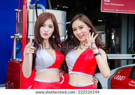 BURIRAM - OCTOBER 5: Unidentified model with racing car on display at The 2014 Autobacs Super GT Series Race 7 on October 5, 2014 at Chang International Racing Circuit, Buriram Thailand