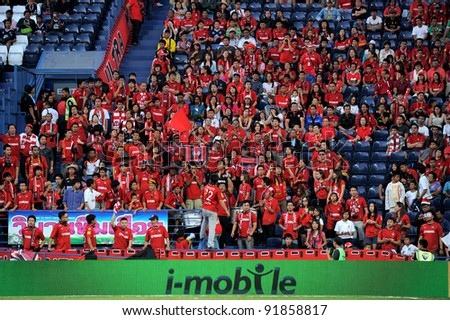 BURIRAM THAILAND-DECEMBER 31:Fan Club of Muangthong UTD during Thai Premier League (TPL) between  Buriram PEA(B) and MuangThong utd (R) at I-mobile Stadium on -DECEMBER 31, 2011 Buriram Thailand