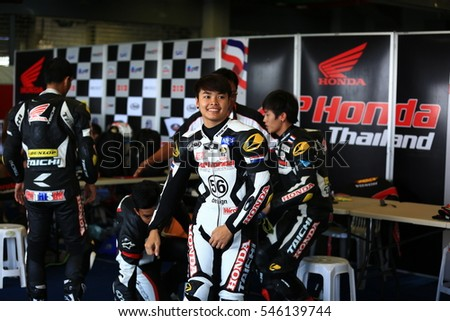 BURIRAM,THAILAND-DECEMBER 3: Muklada Sarapuech of AP Honda Racing prepare before race during qualify at ASIA ROAD RACING CHAMPIONSHIP at Chang International Circuit on DECEMBER 3,2016 inThailand.