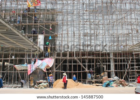 BURIRAM, THAILAND - JULY 6 : Unidentified workers are working on Taweekit Plaza construction building site on July 6, 2013 in Buriram, Thailand.