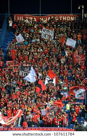 BURIRAM,THAILAND-MAY30:Unidentified SCG MuangThong utd. supporters during Thai Premier League between between BuriramUTD.and SCG Muangthong UTD.at I-mobile Stadium on May 30,2012 in Buriram, Thailand - stock photo