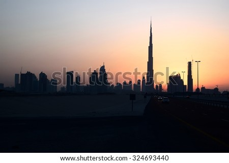 burj khalifa in sunset, business bay, Dubai, United Arab Emirates - stock photo