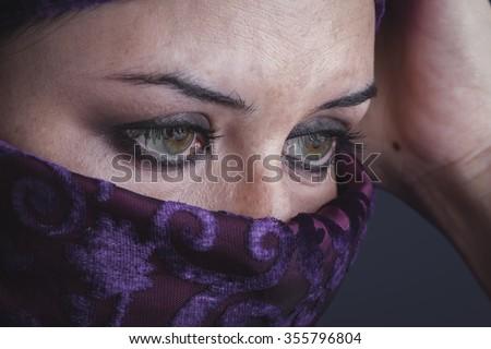 burka Beautiful arabic woman with traditional burqa veil - stock photo