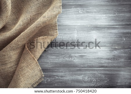 burlap hessian sacking on wooden background