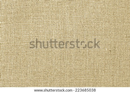 Burlap or linen fabric texture background - stock photo