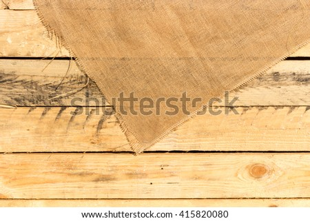 Burlap texture on wooden background