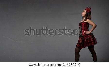 burlesque dancer looking high, empty space - stock photo