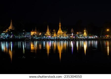 Burmese Architectural Style of Wat Chong Klang (r) and Wat Chong Kham (l) at dusk. Mae Hong Son, Northern Thailand - stock photo