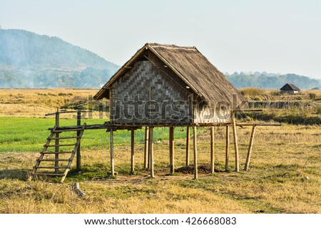 Burmese cottage made from bamboo structure locate in field of rice or rice farmer.