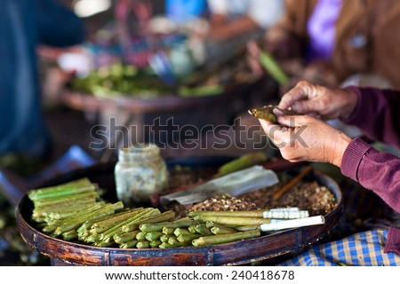 Burmese home-rolled cigar at local market, Myanmar