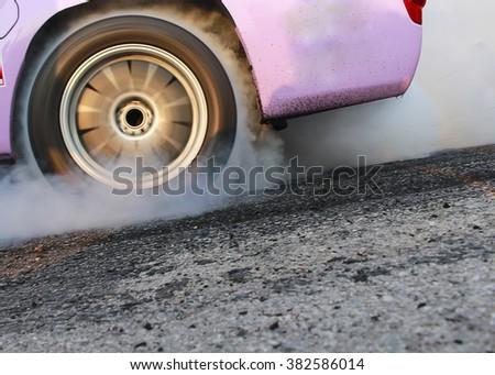 Burn Out racing car soft focus - stock photo