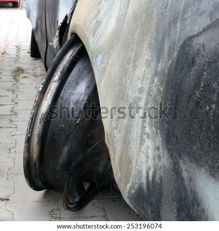 Burn sport car - left rear wheel - stock photo