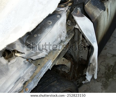 Burn sports car wreck  - stock photo