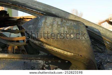 Burn sports car wreck - right mirror  - stock photo