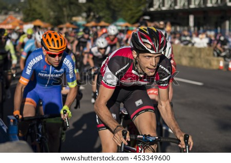 Burnaby, B.C., Canada - July 14, 2016 - Bicycle racers racing in the Giro Di Burnaby bike race in Burnaby, B.C., Canada on July 14, 2016