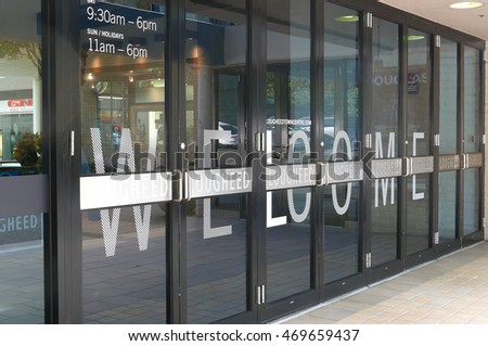Burnaby, BC, Canada - July 11, 2016 : One side of mall entrance with welcome sign on door in Lougheed Town Centre mall