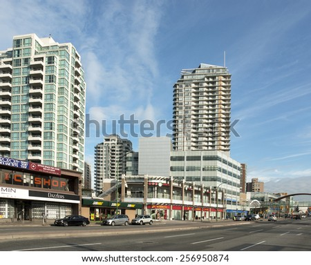BURNABY - JAN. 30, 2015: Kingsway is the bussiest street in Metro Vancouver. Over 400 stores and services are located in Metropolis at Metrotown, the largest shopping centre in British Columbia.   - stock photo