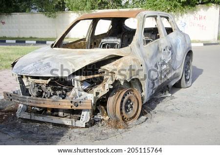 Burned car - stock photo