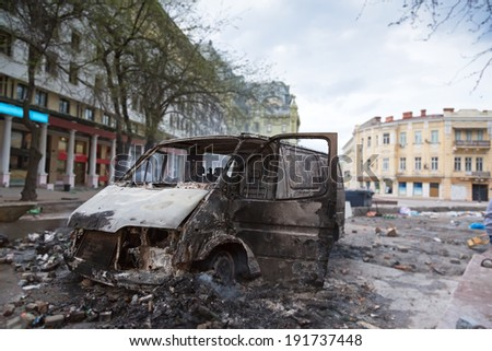 Burned car in the center of city after unrest in Odesa, Ukraine  - stock photo