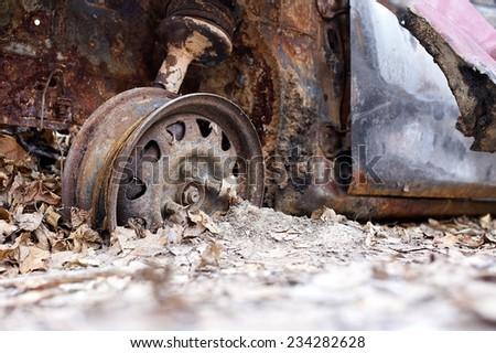 Burned car wheel - stock photo